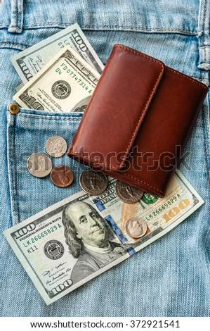 purse money on jeans background - stock photo