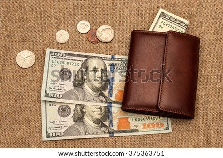 purse money. on linen cloth background - stock photo
