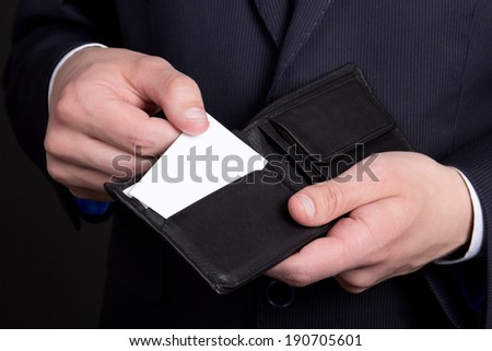 purse with blank visiting card in business man hand - stock photo