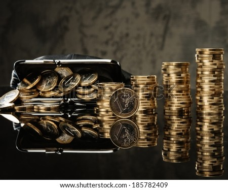 Purse with lot of euro coins  - stock photo