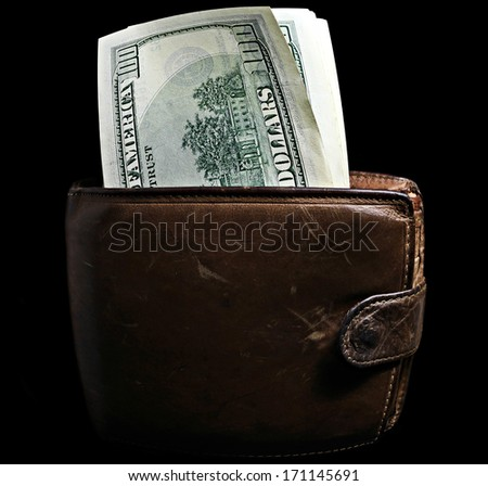 Purse with pack of dollars isolated on black. - stock photo