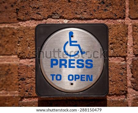 push button handicap door opener. - stock photo