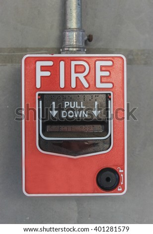 Push button switch fire and telephone on concrete wall - stock photo