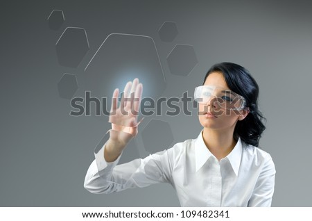 Push button transparent touch interface. Put logo, text or product. Brunette pressing copyspace sensor hexagon key. Future collection series. - stock photo