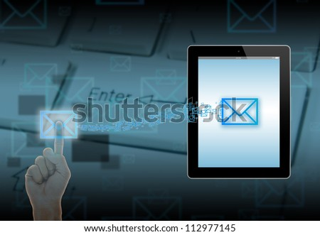 Push Mail icon send to touch-screen illustration tablet-pc on keyboard background. - stock photo