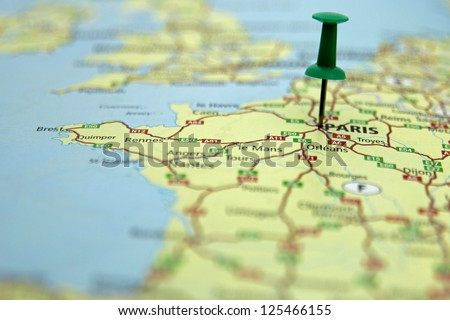 push pin indicating the position of Paris, France - stock photo