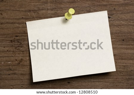 Push pin note on wooden board. - stock photo