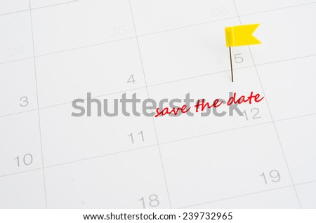Push pin on a calendar-save the date - stock photo