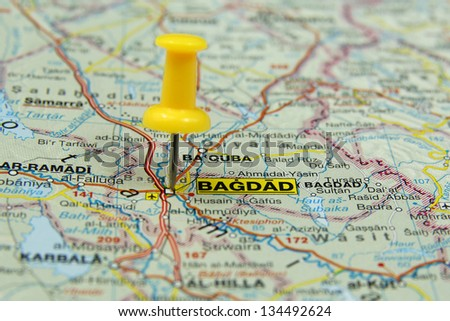 push pin pointing at baghdad iraq