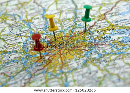 push pins on a tourist map- London, England - stock photo