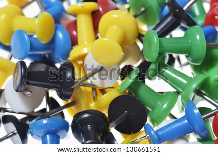 Push pins on white background