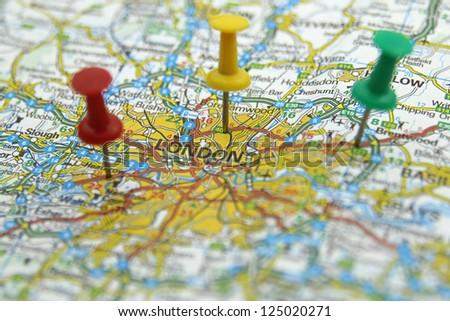 Push pins pointing at London, England - stock photo