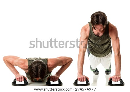 Push up exercise. Studio shot over white. - stock photo
