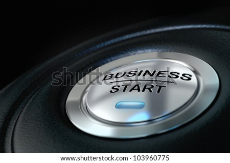 pushed business start button over black background, blue light, symbol of new businesses - stock photo