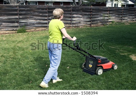 Pushing a battery-powered mower.  Much better for the environment!