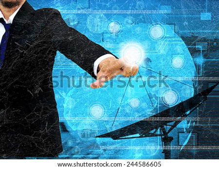 pushing a touch screen interface in the old paper - stock photo