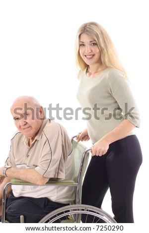 Pushing Grandpa - stock photo