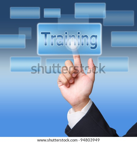 pushing Training  button on a touch screen interface - stock photo