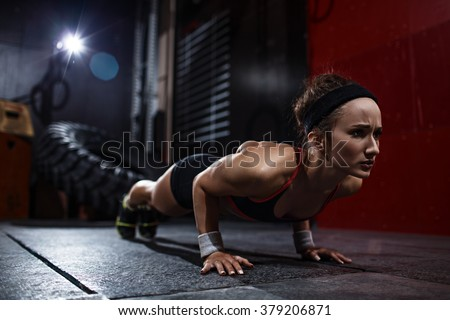 Pushing up in gym - stock photo