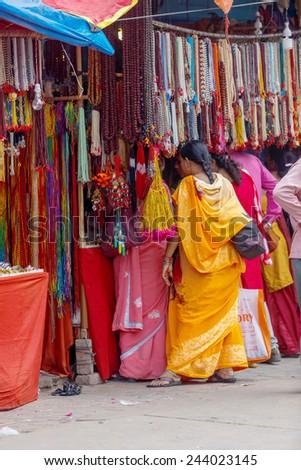 PUSHKAR,INDIA - Circa November,2014 : Unidentified women with their traditional dress in pushkar streets during Pushkar Mela ,Rajasthan, India - stock photo