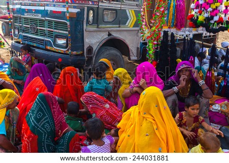 PUSHKAR,INDIA - Circa November 2014 : Unidentified women with their traditional dress sit around the truck and wait for attending pushkar mela