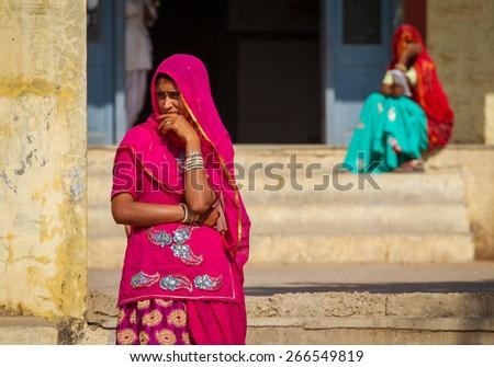 Pushkar, India - December 4, 2012: Indian women dressed in the traditional hindu dress - Sari in Pushkar, India. - stock photo