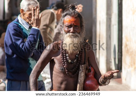 PUSHKAR, INDIA- JANUARY 6: Sadhu in Pushkar on January 6, 2009 in Pushkar, Rajastan, India. - stock photo
