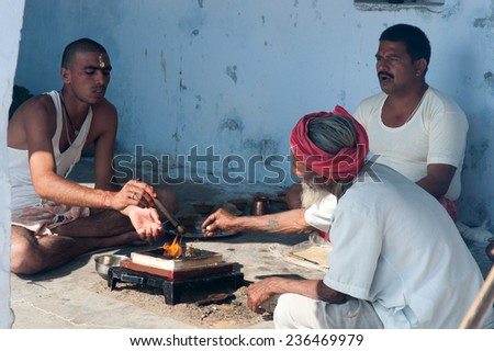 PUSHKAR, INDIA- JANUARY 7: Unidentified people are participating in puja on January 7, 2009 in Pushkar, Rajastan, India. - stock photo