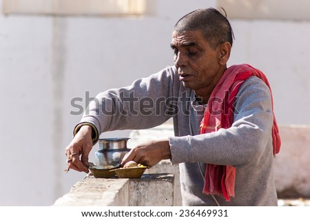 PUSHKAR, INDIA- JANUARY 6: Unidentified people are starting a new day in Pushkar on January 6, 2009 in Pushkar, Rajastan, India. - stock photo