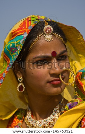 PUSHKAR, INDIA - NOVEMBER 21: An unidentified girl attends the Pushkar fair on November 21, 2012 in Pushkar, Rajasthan, India. Pilgrims and camel traders flock to the holy town for the annual fair. - stock photo