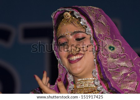 PUSHKAR, INDIA - NOVEMBER 23: An unidentified girl participate in the competition of Indian fashion on November 23, 2012 in Pushkar, Rajasthan, India. Portrait girl in colorful ethnic attire.