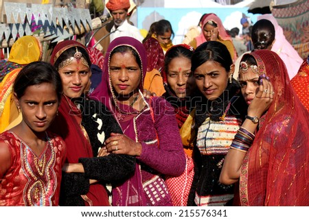 Pushkar, India, November 28, 2012: Beautiful group of Indian girls at Pushkar fair, in the Indian Rajasthan state, with the typical colored dress - stock photo
