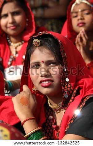 PUSHKAR, INDIA - NOVEMBER 21: Group of Indian girls in colorful ethnic attire attends at Pushkar camel fair on November 21, 2012 in Pushkar, Rajasthan, India. - stock photo