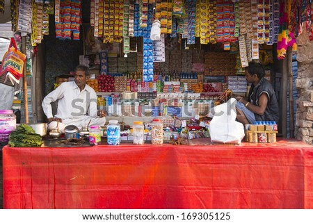 PUSHKAR, INDIA - NOVEMBER 15: shops at amusement park during traditional camel mela in Pushkar on November15 ,2013 in Pushkar, Rajasthan, India - stock photo