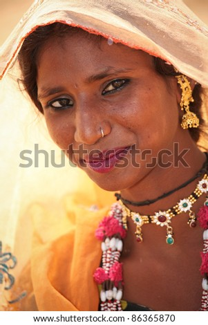 PUSHKAR, INDIA - NOVEMBER 19: Unidentified girl at the Pushkar fair.   Pilgrims and camel traders flock to the holy town for the annual fair.  November 19, 2010 in Pushkar, Rajasthan, India