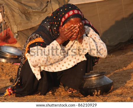 PUSHKAR, INDIA - NOVEMBER 19: Unidentified woman at the Pushkar fair.  Pilgrims and camel traders flock to the holy town for the annual fair on November 19, 2010 in Pushkar, Rajasthan, India