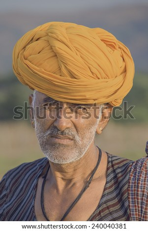 PUSHKAR, INDIA - OCTOBER 27, 2014: Unidentified Indian man attended the annual Pushkar Camel Mela. This fair is the largest camel trading fair in the world. - stock photo