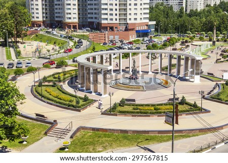 PUSHKINO, RUSSIA - on JUNE 13, 2015. City landscape in the summer afternoon. A memorial in the downtown and multystoried new building