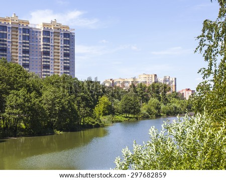 PUSHKINO, RUSSIA - on JUNE 13, 2015. City landscape in the summer afternoon, Embankment of Serebryanka river