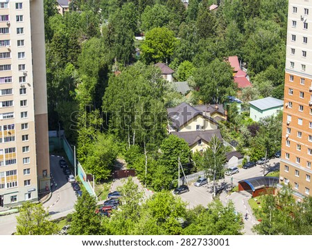 PUSHKINO, RUSSIA - on MAY 26, 2015. City landscape in the spring afternoon. Top view.