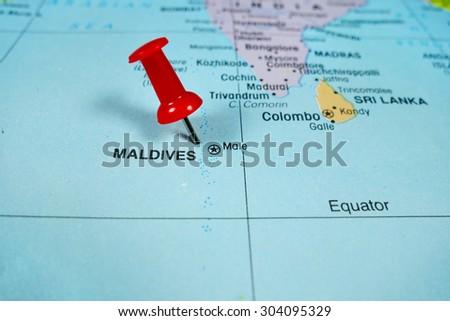 pushpin marking on Maldives map - stock photo