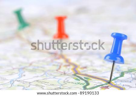 pushpin on a tourist map - stock photo