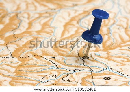 Pushpin on Nameless Map - stock photo