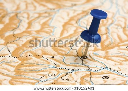 Pushpin on Nameless Map - stock photo