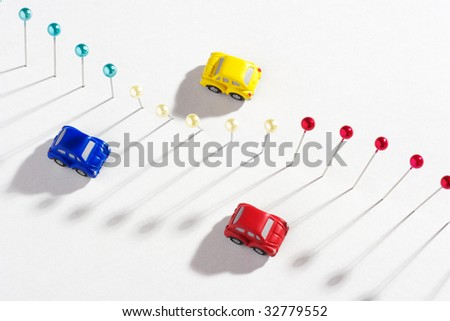 Pushpins and cars