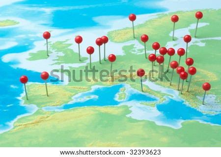 Pushpins on a map of Europe - stock photo