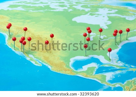 Pushpins on a map of USA - stock photo