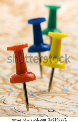 Pushpins on nameless geographic map - stock photo