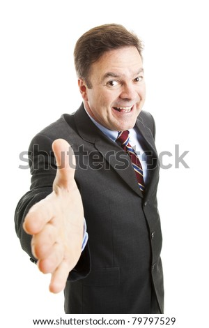 Pushy salesman with an oversized grin, coming in for a handshake.  Isolated on white. - stock photo