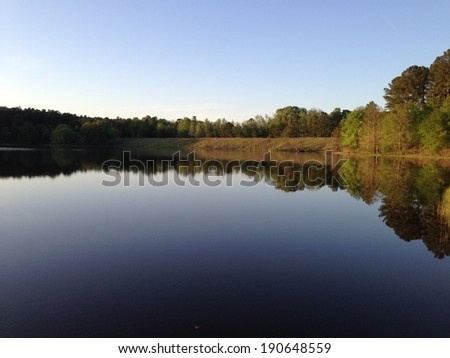 Puskus Lake and dam in Holly Springs National Forest, Mississippi - stock photo